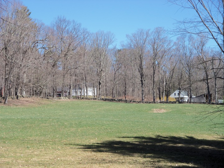 The farmhouse sits to across the road from the meetinghouse, right. The view is from the Cartland family burial ground.