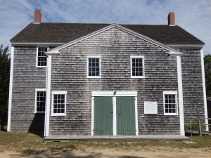 Classic shake siding, weathered gray, is a common Cape Cod theme.